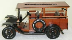 """1919 halack truck model    # 19 DH  this truck served the construction industry just fine.  celebrate the history of the profession. give this one as a gift to your favorite carpenter. he'll appreciate the woodworking and details.   Built from: genuine mahogany, black ebony, solid maple w / painted black wheels and fenders and a copper grill  Approx. size 14"""" Long X 10"""" Tall X 8"""" Wide"""