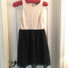 one day  saleCream lace and Navy blue dress Beautiful cream and navy dress with button back and lace top - flowing bottom light and perfect for summer-worn one time - tiny make up spot on INSIDE middle of top-  un noticeable when on Dresses Mini