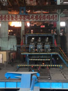 Where the hot steel is pressed out in bars before being moved off to cool- Chollima Steelworks, Kangson County, North Korea