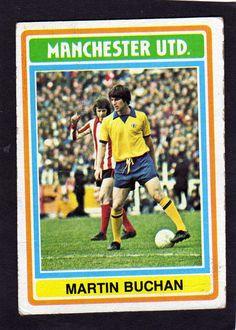 Martin Buchan Topps Trading Card in yellow and blue Man Utd kit.