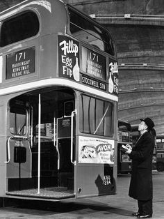 London transport RTL326  having adverts inspected 1950's.