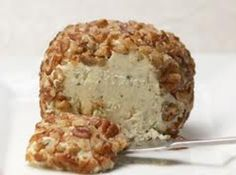 A long-time family friend gave us this wonderful recipe for a Blue Cheese Ball. It has become one of our favorite appetizers.  Absolutely delicious with blue cheese and onion, rolled in chopped pecans!  Enjoy!