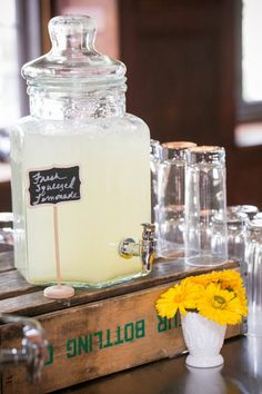 beverage station at event with fresh squeezed lemonade chalk sign on a rustic drink station beverage dispenser at Willowdale Estate, Topsfield Massachusetts venue for weddings and events. willowdaleestate.com