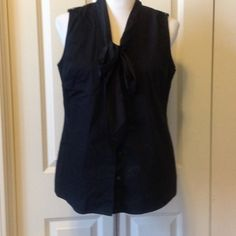 Black Bow Tie Sleeveless Top Basic black button down with a silky bow. 68 cotton 28 polyester 4 spandex The Limited Tops Button Down Shirts