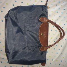 Navy blue long champ brand new condition- only used once. Straight from Paris, bought it when I was visiting. Willing to negotiate price Longchamp Bags Totes