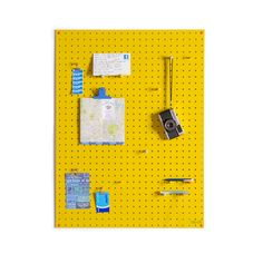 love this vibrant yellow pegboard.