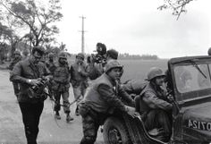 Walter Cronkite and a CBS camera crew use a jeep for a dolly during an interview with the commanding officer of the 1st Bn, 1st Marines during the battle of Hue City, February 1968. (U.S. Marine Corps/National Archives)