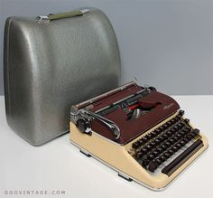 RARE OLYMPIA DE LUXE SM3 1950's BURGUNDY AND DARK CREAM MANUAL TYPEWRITER WITH BURGUNDY KEYS AND ACCENTS + METAL CASE - AVAILABLE