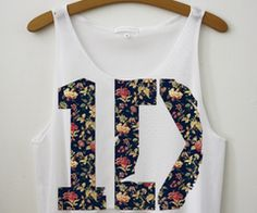 Oh my gosh one direction tank..yes please.  (I would get one for Kristin too of course)