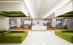 Bright Colored Office Receptionist and Waiting Room with Green Sofas: Bright Colored Office Receptionist and Waiting Room with Green Sofas