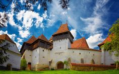 Photo about Viscri fortified church in Transylvania, Romania. It is a UNESCO World Heritage site. Image of summer, eastern, spring - 27976360 Places In Europe, Places To See, World's Most Beautiful, Beautiful Places, Wonderful Places, Visit Romania, Place Of Worship, European Travel, Euro Travel