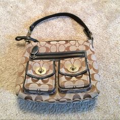 Authentic ❗️Coach Handbag Cute hand bag. Has four pockets 1 i side & 3 in the front. Coach Bags