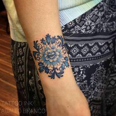 Blue ink floral ornament by Estudio de Tattoo