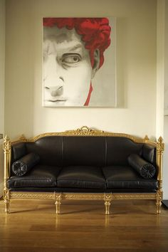 White liv­ing room black leather French Louis XVI style sofa paint­ing pic­ture art­work art Paul Ross Coffey wooden floor­ing real home