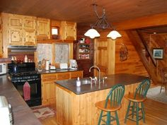 Monson slate counters with knotty pine custom cabinets in kitchen