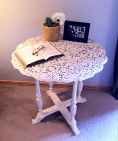Antique scalloped edge round table with cream color DIY chalk paint and dark brown stencil. Distressed and waxed.