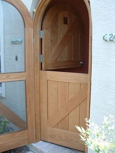 Just Awesome. Solid wood Round Top Dutch door with matching Wood Framed Screen door. Wood be the perfect back door; Arched Doors, Windows And Doors, Arched Front Door, Door Design, House Design, Design Design, Building A Door, Round Door, House Doors