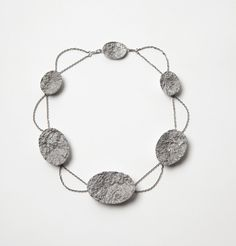 Barbara Schrobenhauser. Necklace: Surfaces, 2015. Aluminium, stainless steel. Photo by: Mirei Takeuchi.