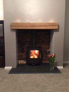 Mendip Churchill wood burning and multi fuel stove we installed in Bradford recently. We knocked out the customers chimney breast to reveal the original brick work at the back, supplied a slate hearth and oak beam. Wood Burner Fireplace, Rustic Fireplace Mantels, Fireplace Hearth, Fireplace Surrounds, Fireplace Design, Fireplace Ideas, Gas Stove Fireplace, Slate Fireplace, Mantel Ideas
