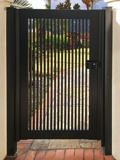 Toyama Single Front view of single panel garden gate with vertical picket style in color black Steel Gate Design, House Gate Design, Door Gate Design, Fence Design, Front Gate Design, Metal Garden Gates, Metal Gates, Garden Doors, Metal Fence