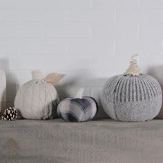 Sweater-covered pumpkins are one of our favorite fall decorating ideas. They're easy to make at home; the hardest part will be deciding which sweater to use! Hit the thrift store or sort through your donation pile, grab a few faux gourds, and start creating your own mini pumpkin patch with these simple instructions. #falldecorideas #upcycle #sweaterpumpkins #diydecor #bhg