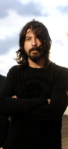 one of the most inspirational figures in music. After losing the leader and lifeblood (Kurt Cobain) of their band, Nirvana, Dave Grohl formed his own band, The Foo Fighters. And he channeled the pain of loss and the joy of life into his work Foo Fighters Dave Grohl, Foo Fighters Nirvana, Music Love, Rock Music, Rock N Roll, There Goes My Hero, Rock Legends, Music Stuff, Music Bands