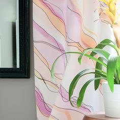 Achieve this marbled look on your curtains with this water paint tutorial inspired by a decorative Jonathan Adler box.