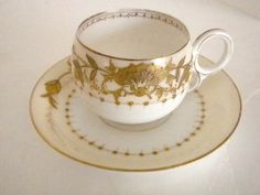 Vintage White and Gold Limoges Tea Cup and Saucer
