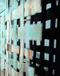 A unique large size copper woven metal art panel offset mounted on a black acrylic base. This copper weave panel is made from up-cycled copper pipe of various sizes and ages, which has been treated with different salts to create a blue/green patina. http://www.wallsloveart.co.uk/shop/metalwork/copper-weave-metal-wall-art-panel