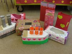 Valentine Holders made from recycled items--could be a cool childrens engineering project