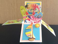 "Front of ""Beachy"" card in a box."