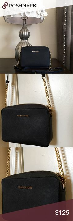 Black Michael Kors Crossbody This classy, stunning Michael Kors crossbody is pre-loved, but shows light wear. It is in absolutely excellent condition! I'm sorry, I'm not interested in trades. Price is firm because of Poshmark's fees. Michael Kors Bags Crossbody Bags