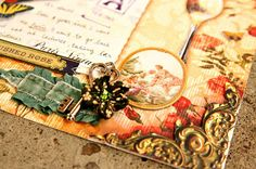 Details from gorgeous scrapbook layout by Fauve van Maanen of the Netherlands using Dove of the East Paris Vintage papers, charms, ribbons, Europe Journey chipboard stickers and more as seen on her blog!