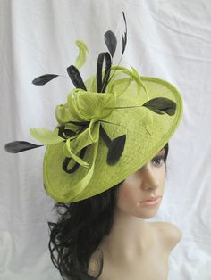 b0395f6d Lime green Feather fascinator with Black trim Shaped disc Fascinator with  double swirls , loops..wedding,races