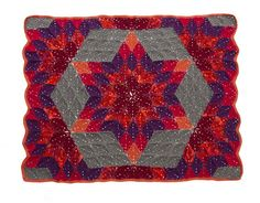 This stunning crocheted throw inspired by the classic Lone Star quilt pattern is one of a kind!