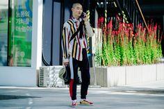 Korean model wearing striped shirt and yellow Vans