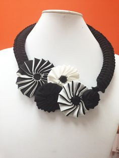 Add some structured floral beauty to your outfit with this handmade statement neckpiece!  http://instagram.com/paradoxjewels