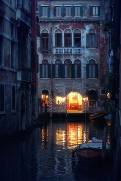 Venice Italy Light at the end of the tunnel of architecture buildings along the canal. Lovely night photo pinned via Brittany Halier.