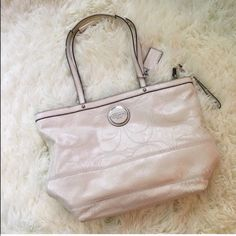 White Patent Leather Coach Tote This is in amazing condition aside from some light scuffing on the bottom right-hand corner as shown, you can barely see it I just did a close-up of it for the photo! 13 inches across bottom. No stains or flaws!! NO TRADES PLEASE Coach Bags Totes