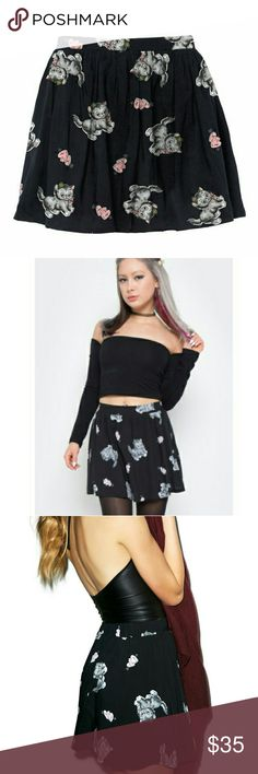 Iron fist cat skirt Here kitty, kitty! This little mini skirt is something sink your claws into! This high waist skirt features an all over printed of precious kittens and hearts on a black background. Perfect to pair up with any solid top and maybe even an adorable cardigan in the fall. Iron Fist Skirts