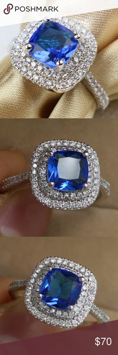 2CT Cushion Cut Blue CZ Halo Ring In .925 Silver 2CT Cushion Cut Blue CZ Halo Ring In .925 Silver  Size 6, 7  2ct (7.6mm x 7.6mm) Cushion Cut Sapphire Blue CZ  surrounded by 2 rows of 1mm crystal gems .925 Sterling Silver band with 6 - 1mm crystal gems down each side Jewelry Rings