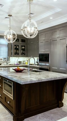 Love the two-tone look with the gray painted cabinets on the perimeter and the stained island. Beautiful contrast