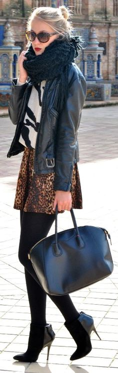 chunky scarf // leather jacket // leopard skirt // pointy toed ankle boots // red lips // statement bag