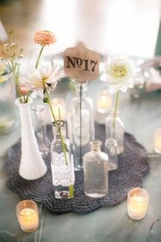 Vintage wedding bottles and table signs. I like this with some babysbreath for shower center pieces.