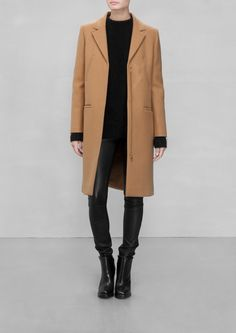 & Other Stories | Wool-Blend Coat. A warm and cozy wool coat featuring a sharp, pointy collar and zipped front.