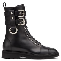Put an authoritative stamp on your look in these black leather boots. Detailed with silver-plated metal trims and buckles, they pack a punch in the most sophisticated way possible.