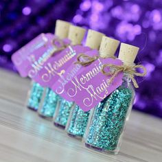 Deep under the frothy waves of the rolling sea, mermaids collect the shining, sparkling magic that can only be found on the ocean floor. Brilliantly blue and glittering like the sunrise on the lapping water, this magic will help you transform your next underwater birthday party into a truly enchanting engagement. These glittering party favors are the perfect ending to your little mermaids' next bash and can be used as decorations and gifts for attendees. Quote: Mermaid Magic Contents: Teal…