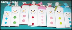 candy bars covered and decorated as snowmen