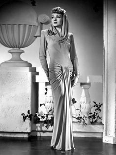 Claudette Colbert: The Palm Beach Story.  The draping of this evening dress is absolute perfection.