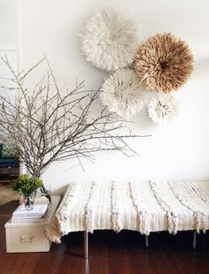 20 Ways to Decorate with African Juju Hats - Feather Headdresses - Interior Design - Bamileke Juju Hat and Moroccan Wedding Blanket in a home entryway